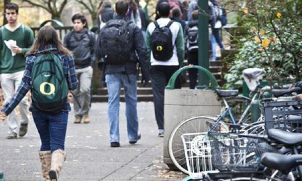 students walking next to parked bikes